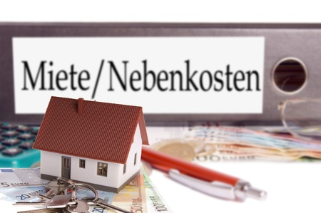 mietspiegel: euro money and file folder with the german words Rent and utilities costs