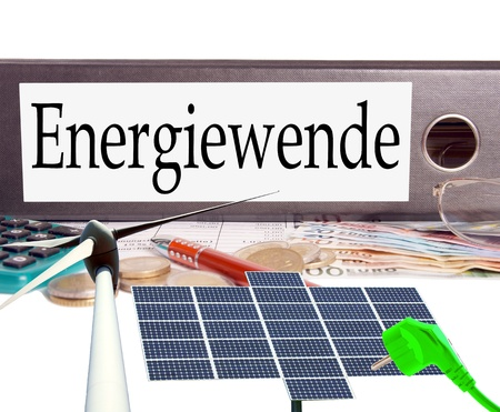 electricity prices: euro money and file folder with the german words energy change