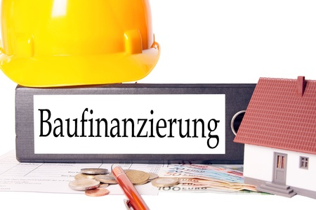 bausparen: Hard Hat and file folder with the german word property finance Stock Photo