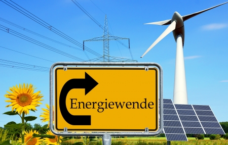 electricity tariff: renewable energies and a sign with the german word energy Transition