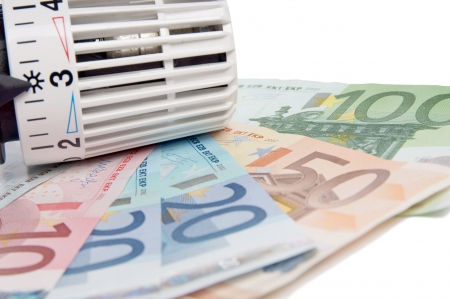 regulators: heating thermostat with banknotes Stock Photo