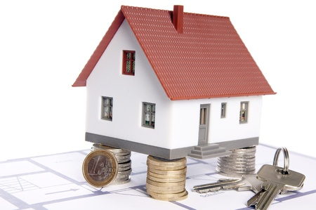 homeowners: small house with a floor plan and euro money Stock Photo