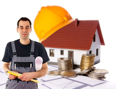 Construction worker with a small house and euro money photo