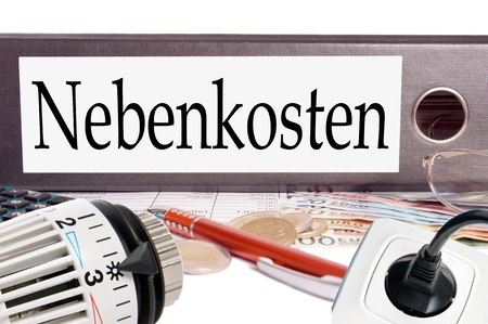 file folder with the german word additional costs photo