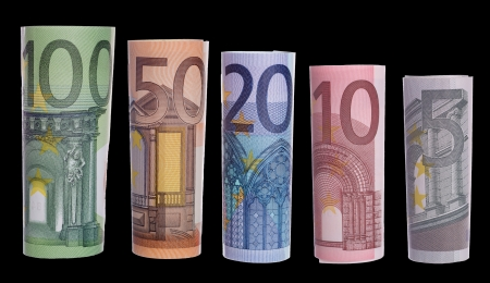 euro banknotes over a black background photo