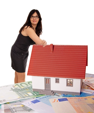 Woman based on a small house with banknotes Stock Photo - 18468254
