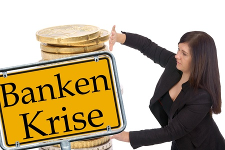banking crisis: Businesswoman with euro coins and shield with the german words banking crisis Stock Photo