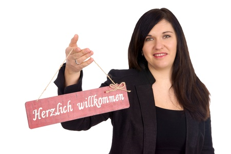 cordially: woman and a sign with the german words cordially welcome