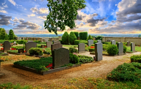bereavement: graveyard with beautiful sky and clouds