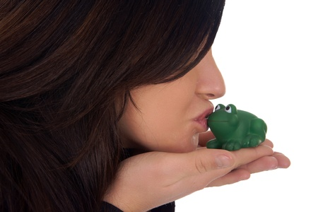 but think: pretty woman kissing a frog Stock Photo