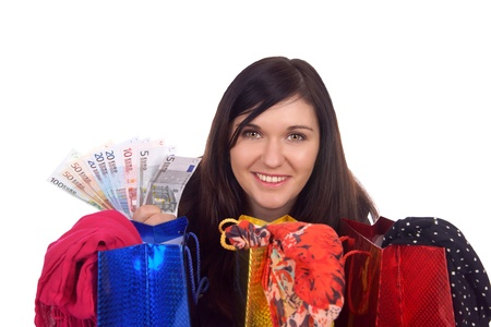 young woman with shopping bags and euro banknotes photo