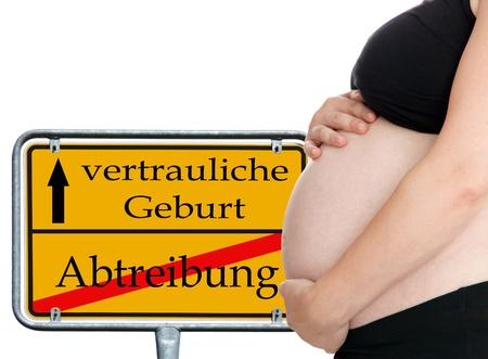 ortsschild: pregnant woman and shield - confidential birth
