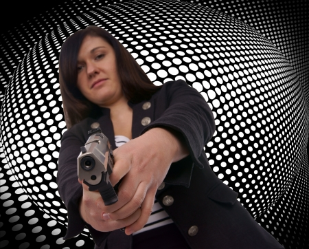 charismatic: woman with handgun with grid background Stock Photo