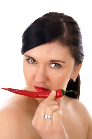 woman with hot chili pepper photo