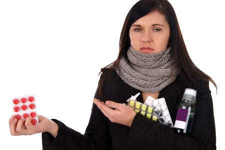 sick woman with pills and medicines Stock Photo