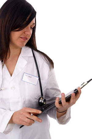 young doctor with stethoscope and writing board photo