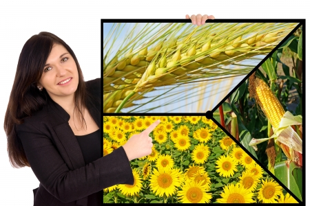 Woman and sign with Sunflower, corn and grain photo