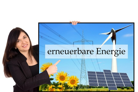 Woman with sign and the german words renewable energy photo