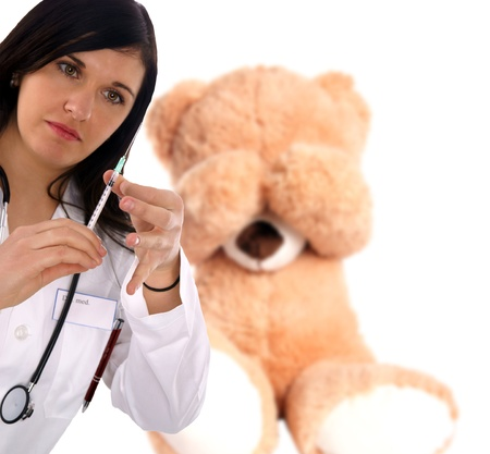 young doctor with stethoscope and syringe photo
