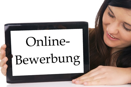 Woman with tablet pc and the german words online Application photo
