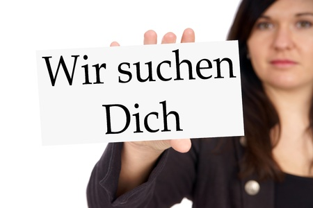Woman with List and the german words We are looking for you Stock Photo