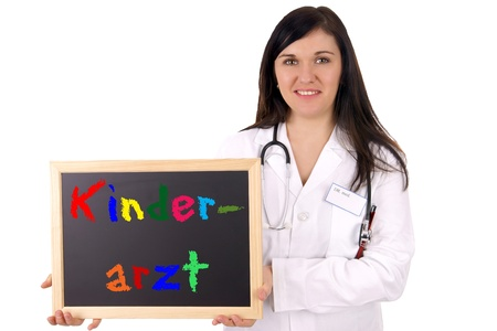 Doctor with sign and the german word Pediatrician photo