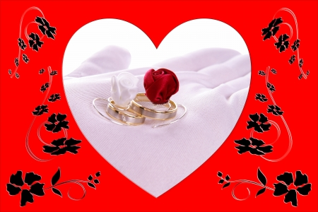 Hand holding Wedding Rings with heart frame Stock Photo
