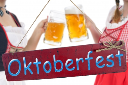 two pretty woman with a beer mug and plate - Oktoberfest photo