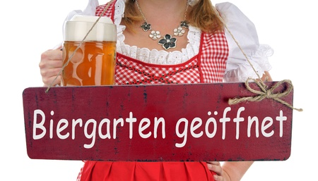 pretty woman with a beer mug and sign with the german words beer garden open Stock Photo