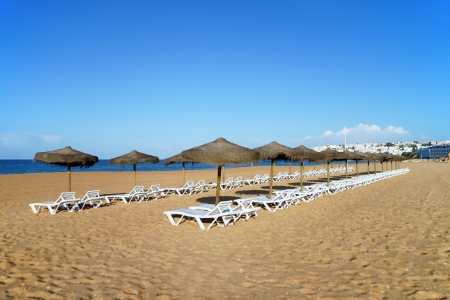 Beach with sunbeds and umbrellas