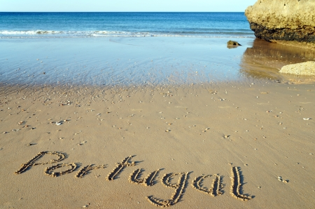Sea and beach with the word Portugal photo