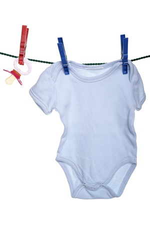 teats: baby clothes and pacifier on a clothesline