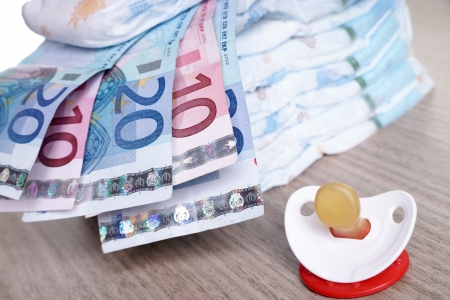 Baby Diapers with euro banknotes and pacifier photo