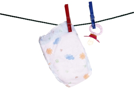 teats: Baby diaper and baby sucker on a clothesline