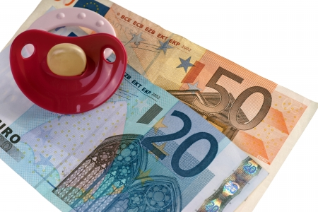 teats: pacifier and euro banknotes Stock Photo