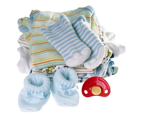 baby clothes and pacifier isolated over a white background photo