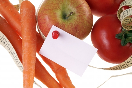 Fruits and vegetables with empty paper and measure tape photo