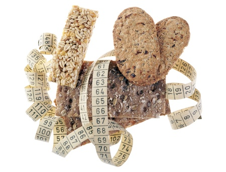 Whole grain crispbread and biscuits with tape measure photo