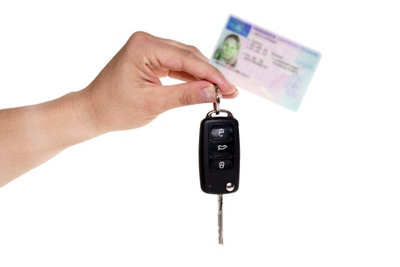 hand holding german driver license with car key