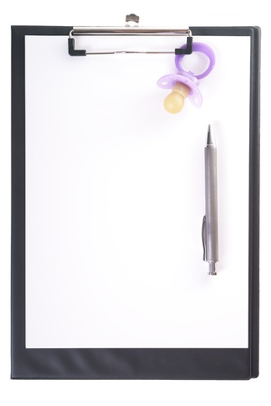 errands: clipboard with pen and pacifier Stock Photo