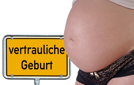 pregnant woman with shield and the german words confidential birth photo