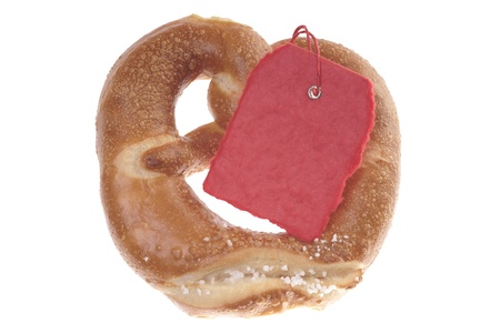 isoliert: Pretzel with blank shield isoliert over a white backgound Stock Photo