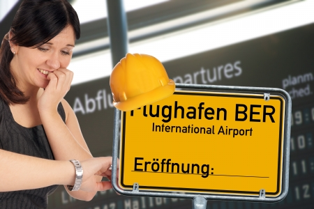ber: desperate woman and shield with the german words Berlin Brandenburg Airport