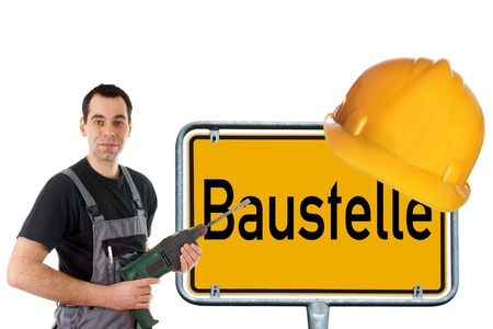 construction worker and sign with the german word construction photo