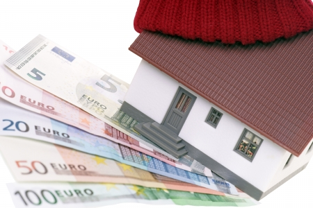 household money: small house with hat and euro banknotes Stock Photo