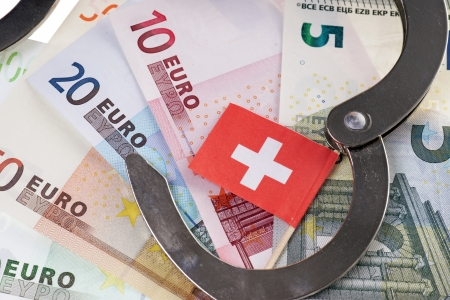 evasion: Euro notes with Swiss flag and CD