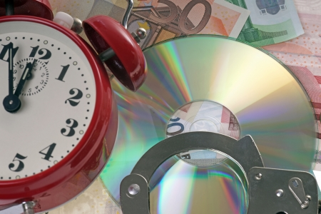 treaties: Euro banknotes with handcuffs and alarm clock