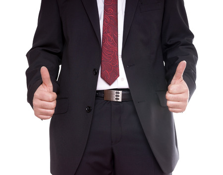 Businessman holding thumbs up photo