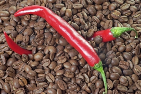 full bodied: Chilli peppers with coffee beans Stock Photo