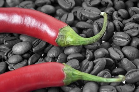 Chilli peppers with coffee beans in black and white and color photo